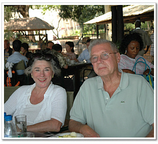 Chairman, Virginia Austin Schubert, and her husband, Founding Board Member, Richard Schubert, taking a lunch break, while on safari in Livingstone.